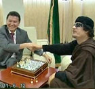 Muammar Gaddafi plays chess