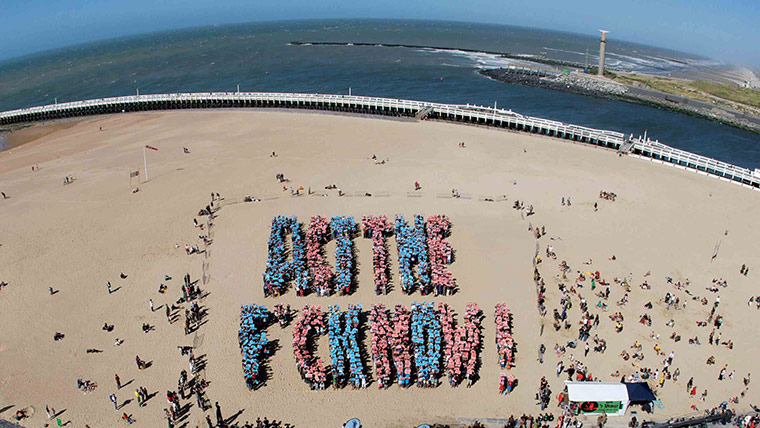 August 2008 An Aerial View Shows People Forming Giant Letters That Read Act The Fck Now During Filming Of A Video Clip On Beach In Oostende