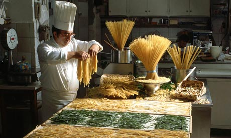 Making pasta in the traditional manner (the hat's optional). Photograph: Vittoriano Rastelli/Corbis