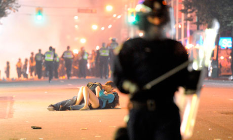 Vancouver kiss couple were knocked down by riot police | World news ...