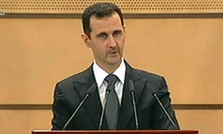 Syrian President Bashar al-Assad addressing the nation from Damascus University