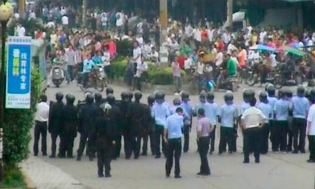Riot police block a road in Zengcheng, China