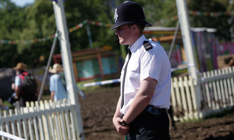 A policeman at the Glastonbury festival, where a body was found in a backstage area