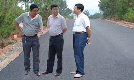 Local officials inspect a highway project in China's Sichuan province