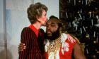 Nancy Reagan sitting on lap kissing Mr. T