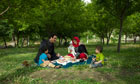 Family enjoy picnic in Babur Gardens, Kabul