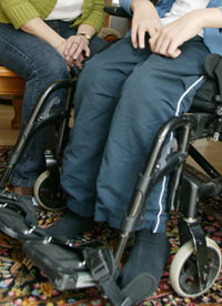 Child in wheelchair with carer