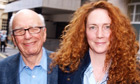 Murdoch and Brooks leave London residence