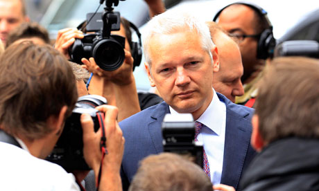 Julian Assange arrives at the high court in London on 13 July 2011.