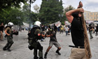Protestors fight with riot police in Athens
