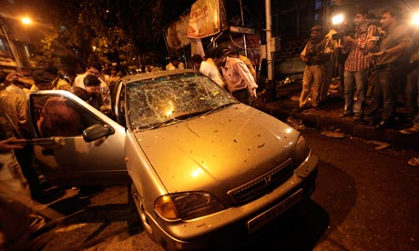 Police officers inspect the site of an explosion at Dadar in Mumbai, India