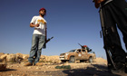 Rebel fighters controlling the frontline of Al-Qawalish in the western mountains of Libya