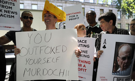 Protesters against Rupert Murdoch outside his home on 5th Avenue in New York