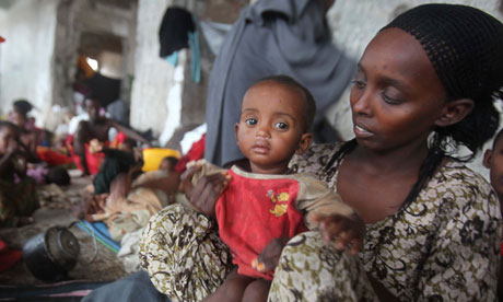 Somali woman holds child