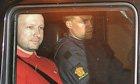 Anders Behring Breivik seen through the window of a police car