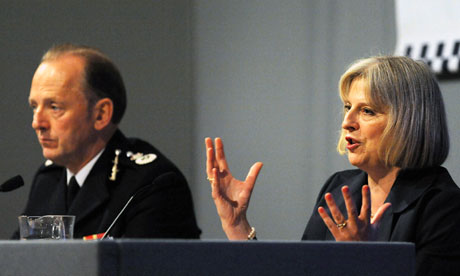 Home secretary Theresa May sits alongside Acpo president Sir Hugh Orde
