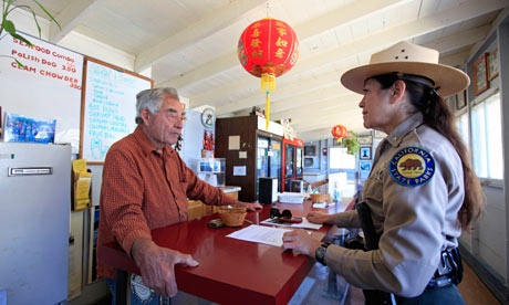 Before 2 August, already short of money: superintendent Danita Rodriguez chats to a store owner at China Camp, a former shrimping village on the north shores of San Francisco Bay, one of 70 California state parks slated for closure next year. Photograph: Eric Risberg/AP