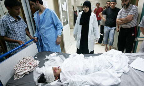 Nurse at the hosptial in Misrata in Libya looks at a boy injured in the fighting
