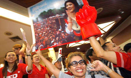 Yingluck Shinawatra, leader of the Puea Thai party, cheered by