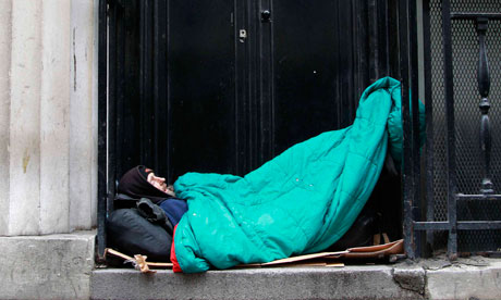Homeless man sleeps in a doorway in central London