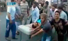 Syria: unverified video still shows a man being rushed to hospital