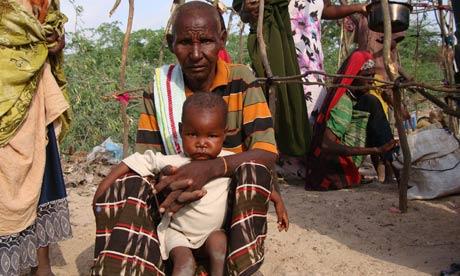 Refugee waits for food aid in Mogadishu