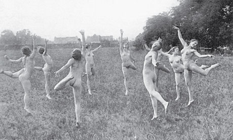 Women dancing naked in a field