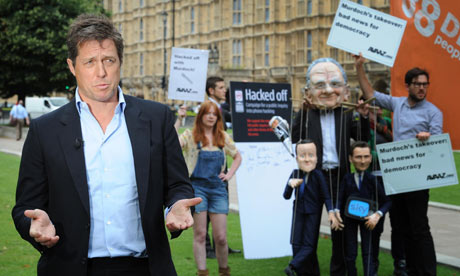 Hugh Grant 'really doesn't care about the whole silly showbiz carousel and ...