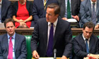 David Cameron addresses an emergency session of parliament following the UK riots