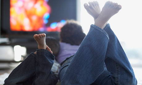 Too much television could shorten your life, putting TV-watching 'in the same ballpark as smoking and obesity', say researchers. Photograph: Fancy/Veer/Corbis