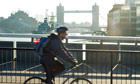 A man cycling to work over London Bridge