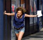 Caitlin Horner runs to her friends to celebrate her A-level results Brighton College 18 August 2011