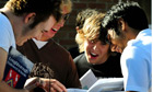 Students look at their A-level results