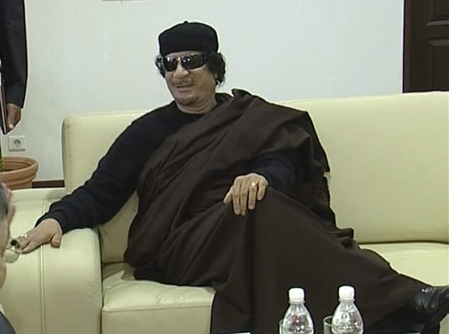 Gaddafi: 12 June 2011: A TV still of Muammar Gaddafi during a meeting