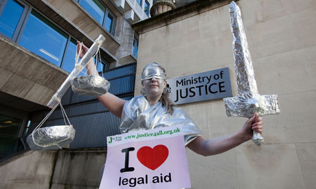 A legal aid campaigner outside the Ministry of Justice in London