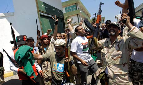 Libyan rebels celebrate taking control of a former military base in Tripoli