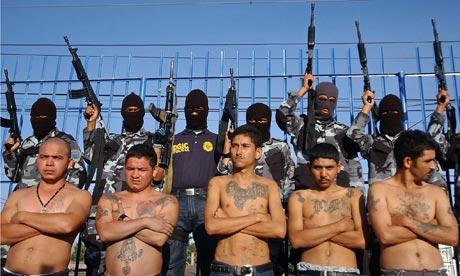 Policemen show several alleged gang leaders in Honduras