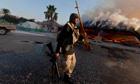 Rebel fighter arrives in Gaddafi's Tripoli compound
