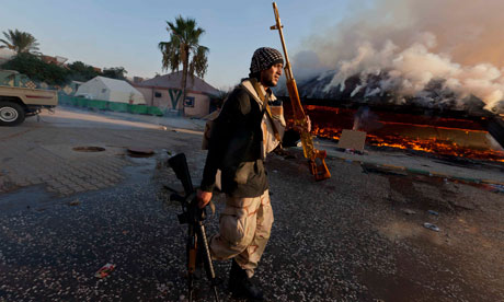 Rebel fighter arrives in Gaddafi's Tripoli compound
