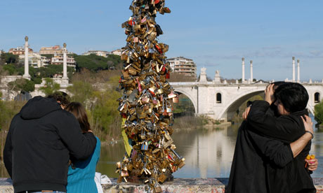 Lovers hang padlocks on Rome&#39;s Ponte Milvio.