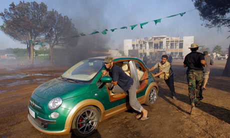 Rebels and car in Gaddafi compound