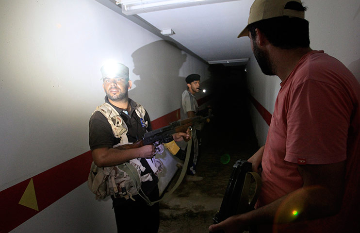 Bab al-Aziziya, Tripoli: Rebel fighters inspect a tunnel in the bunker, Bab al-Aziziya compound