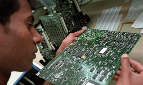 man looking at computer chip