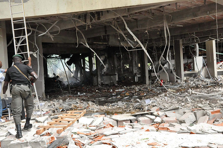 UN Abuja bomb blast: A police officer walks past the blast shattered United Nations building