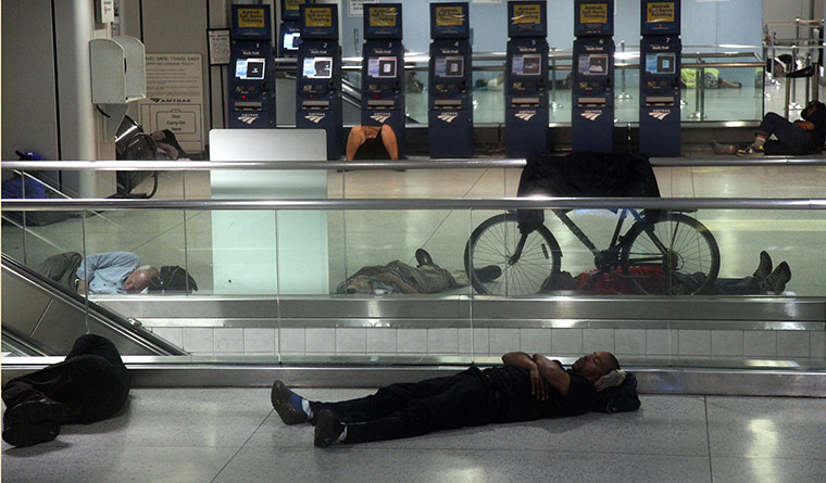 Hurricane Irene: People sleep at Penn Station in New York