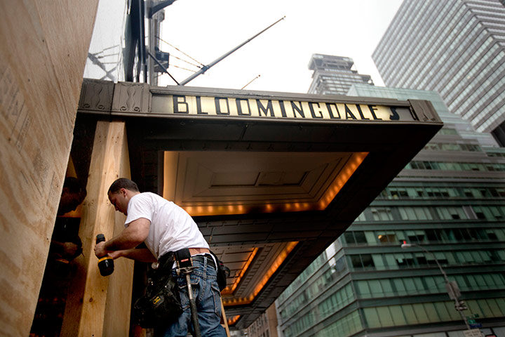 Hurricane Irene: Workmen install plywood over the windows of Bloomingdales, New York