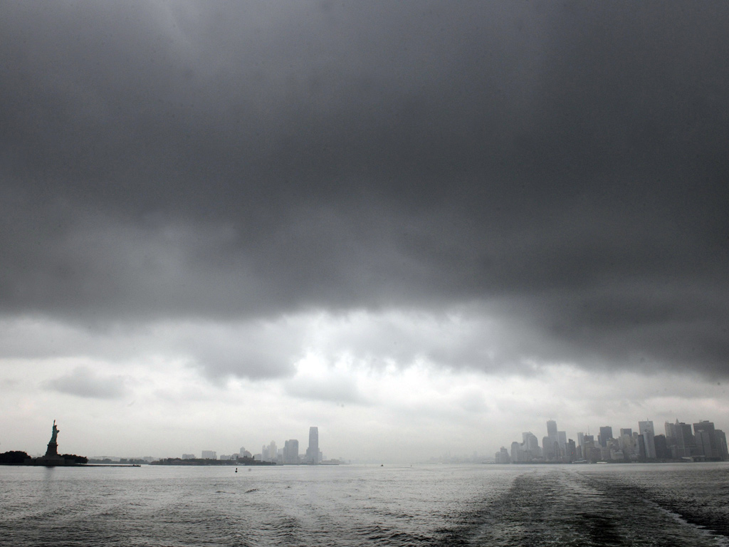 New York skyline is enveloped in the dark clouds as Hurricane Irene approaches