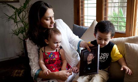 Binosche Barrett, Matthew's wife, with their two children.