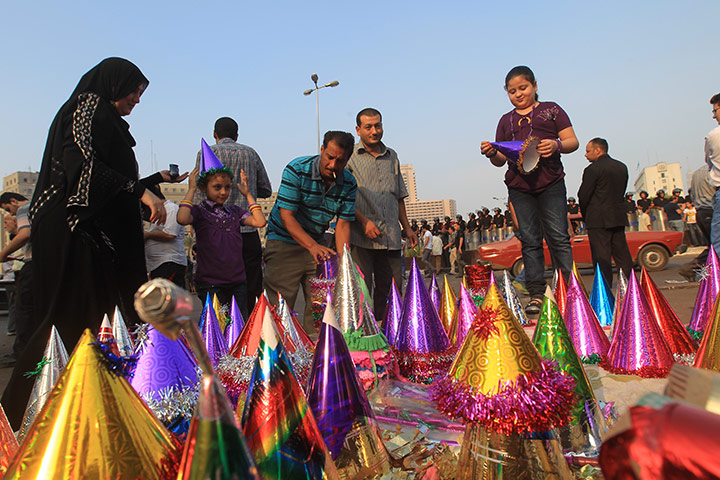 Eid al-Fitr: Cairo, Egypt: A family buy colourful party hats for their daughters