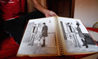 A Libyan rebel fighter shows a photograph album of Gaddafi found at his beach house